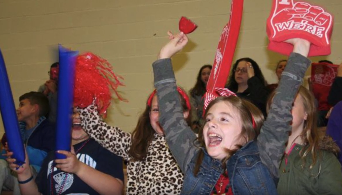 Students cheer on their favorite team during the annual St. Jude's game