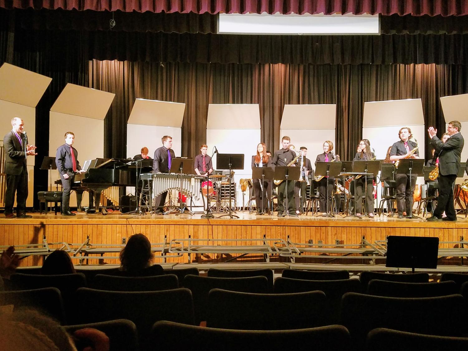 Jazz ensemble gets acknowledged after they finish the last piece of the concert