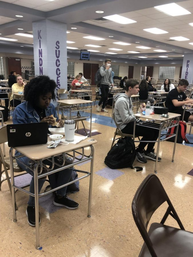 Students eat lunch at their desks following CDC social distancing guidelines.